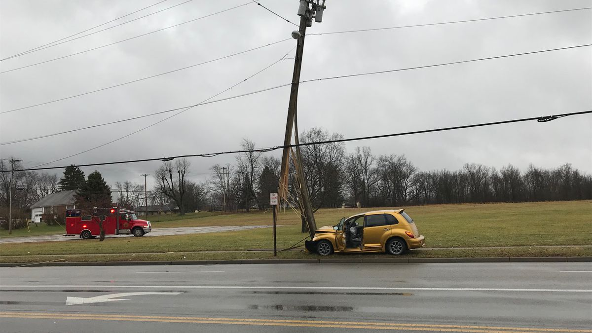 Crash damages utility pole, shuts down road in Springfield